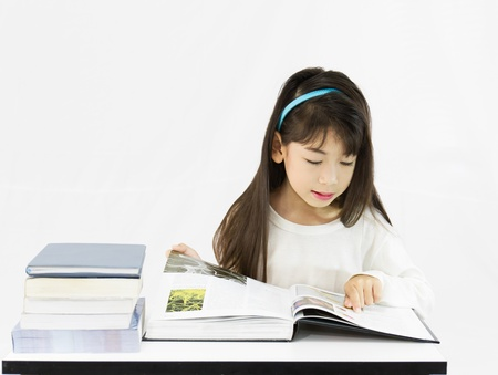 The young student reading the book on a white background photo