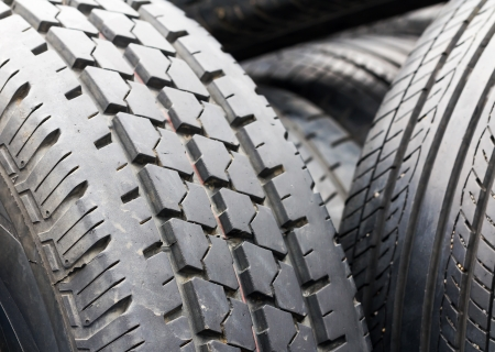 Close up of used tires for rubber recycling photo