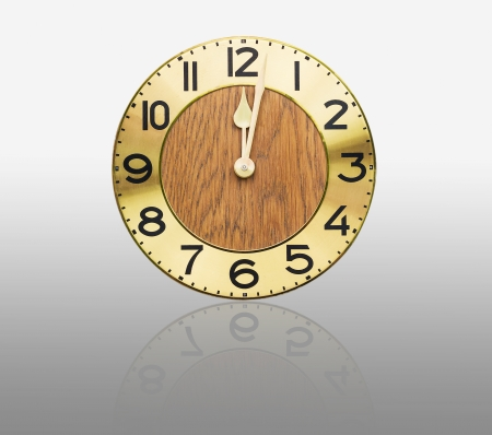 Face old wall clock on gray background photo