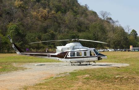 helipad: Helicopter on helipad Stock Photo