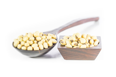 Soybean in wooden spoon on white background Stock Photo - 27334863