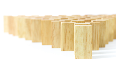 chain reaction: Row wooden domino against the white background Stock Photo