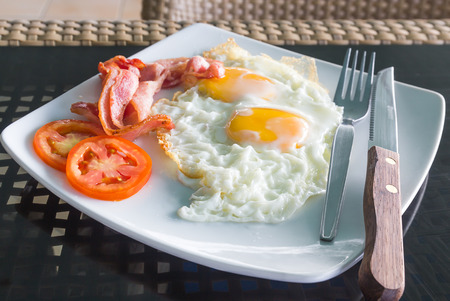 Breakfast in the morning with egg and bacon photo