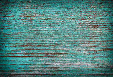 flaking: Green paint peeling from a wooden  showing the wood grain Stock Photo
