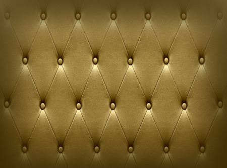 Luxurious dark golden leather seat upholstery use for background photo