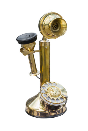 dial plate: Antique golden brass telephone isolated on white  Stock Photo