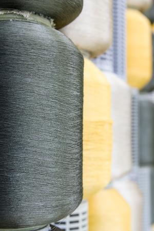 silk thread: Close up of silk thread spools in row Stock Photo