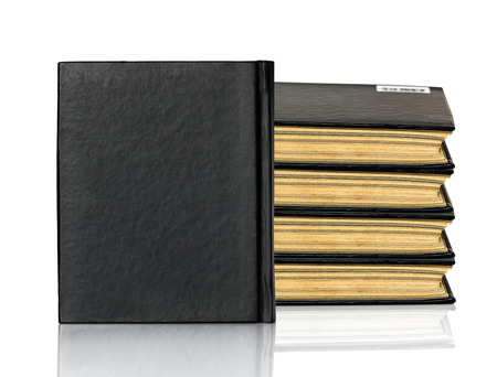 Black blank book,Closed black book is laying on white background photo