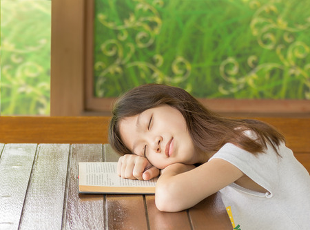 Asian girl sleeping while sitting at desk,Sleeping while learning