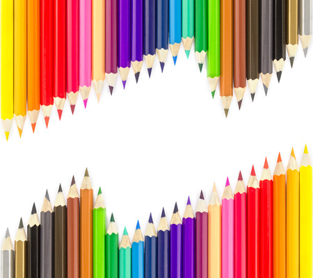 color pencil: Sets of colored pencils in rows on white background