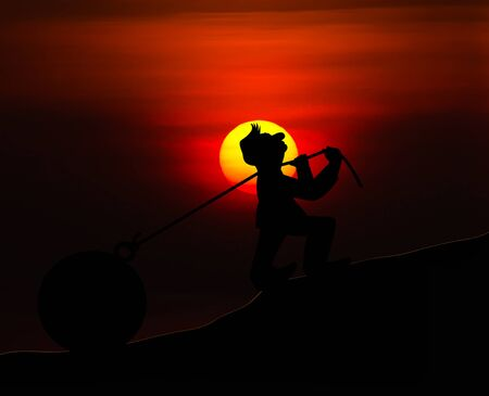 heavy load: Concept man with pulling a heavy load ball silhouette with sunset background Stock Photo
