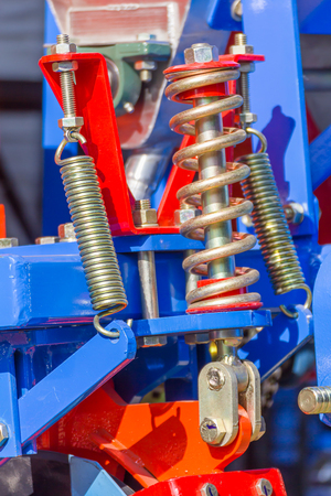 vibration machine: Shock absorbers are used in agricultural machinery