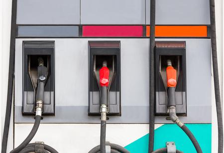 fuel pumps: Fuel pumps petrol ,Three refuel nozzles in gas station