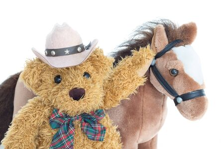 stuffed: Cowboy Teddy bear and horses on white background Stock Photo