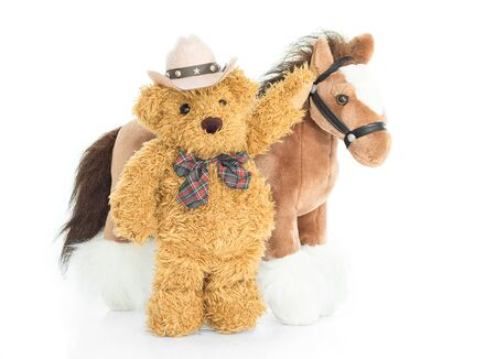 cuddly: Cowboy Teddy bear and horses on white background Stock Photo