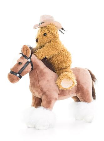 rustler: Cowboy Teddy bear riding a horses on white background