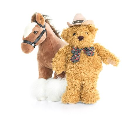 rustler: Cowboy Teddy bear and horses on white background Stock Photo