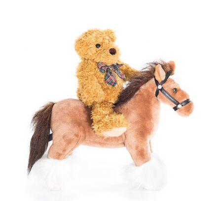 rustler: Teddy bear riding a horses on white background Stock Photo