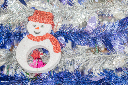 the tinsel: Snowman and tinsel for the holiday background