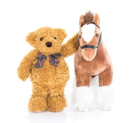 rustler: Teddy bear and horses on white background
