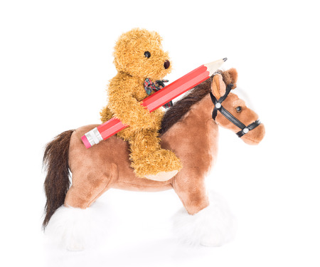 rustler: Teddy bear ride a horse and hold pencil on white background