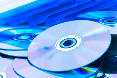 cd rom: Close up of a stack compact discs (CDDVD) Stock Photo