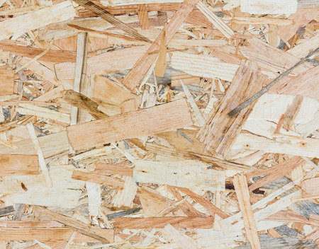 osb: Close up texture of oriented strand board - OSB, Wood board made from piece of wood