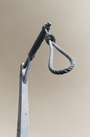 noose: Gallows and hangman noose against a dark sky Stock Photo