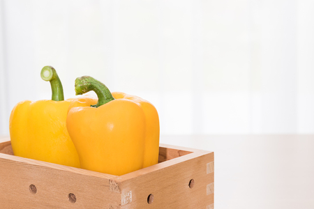 wooden crate: Fresh yellow bell pepper (capsicum) in  wooden crate