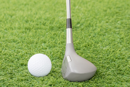 caddie: Close up golf club and ball on green grass