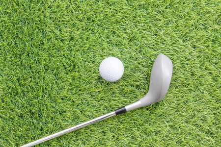 golfcourse: Sport objects related to golf equipment ,Golf club and ball on green grass