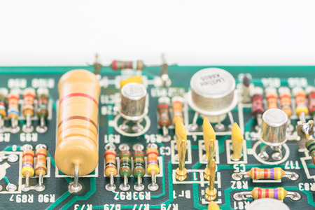 condensers: Closeup electronic hardware . Resistor and condensers assembly on the circuit board Stock Photo