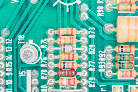 resistor: Closeup electronic hardware .Resistor and condensers assembly on the circuit board