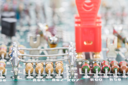 resistor: Closeup electronic hardware . Resistor and condensers assembly on the circuit board Stock Photo