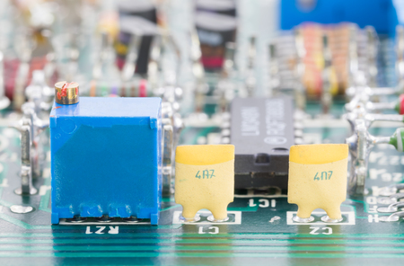 Closeup electronic hardware . Resistor and condensers assembly on the circuit board Stock Photo