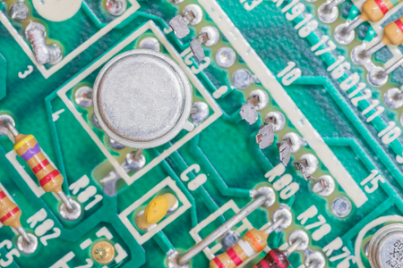condensers: Closeup electronic hardware .Resistor and condensers assembly on the circuit board