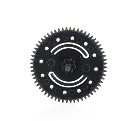 Close up black gear plastic wheel on a white background Banque d'images