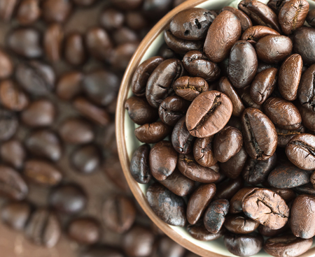 Close up top view roasted coffee beans in coffee cup Stock Photo