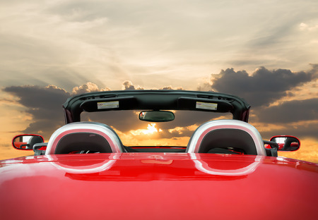 Car rear view the red car with sunset background Imagens