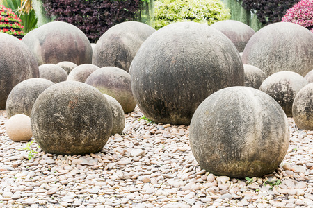 flat foot: Zen stone in a Japanese garden, Stone sphere in the stone garden with footpath