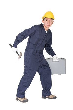 Young handyman  standing with his tool box isolated on white background Stock Photo