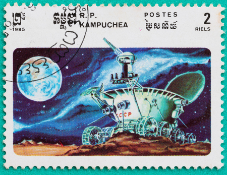 SARABURI, THAILAND-JUNE 04,2017: Used Postage stamps with printed in the Cambodia shows moonwalker explores the lunar craters, circa 1985 Editorial