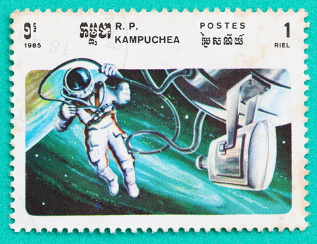 SARABURI, THAILAND-JUNE 04,2017: Used Postage stamps with printed in the Cambodia shows  Cosmonaut Alexey Leonov on space walk, circa 1985 Editorial