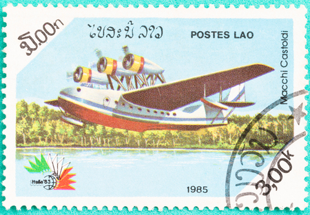 collectible: SARABURI, THAILAND-JUNE 04,2017: Used Postage stamps with printed in laos shows plane, circa 1983 Editorial
