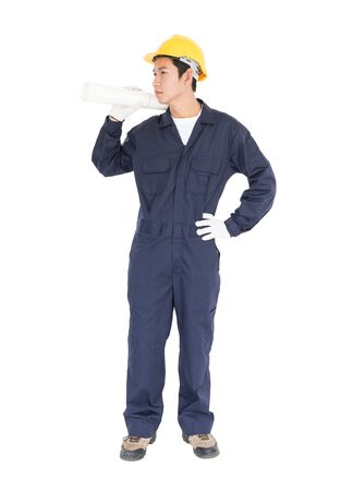 Young worker with yellow helmet holding blueprint isolated over white background