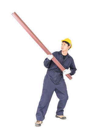 Young plumber in unifrom holding pvc pipe isolated on white background