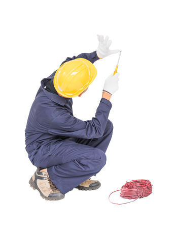 Electrician in unifrom with bunch of wires  invisible wall , isolated on white background cutout Stock Photo