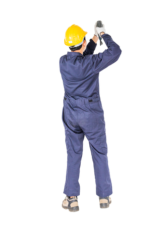 Young handyman in unifrom standing with his electric drill, Cutout isolated on white background