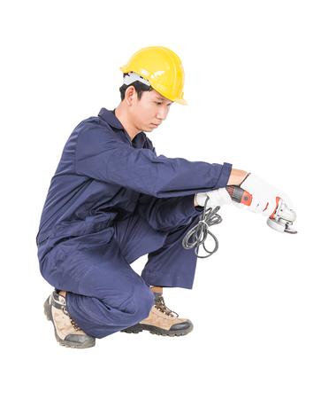 zapatos de seguridad: Joven manitas en molino de retención uniforme, recorte aislado sobre fondo blanco Foto de archivo