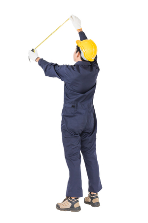 Young worker in unifrom with tape measure, Cut out isolated on white background